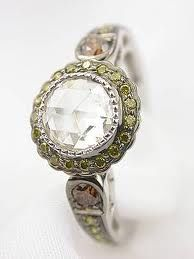 Antique engagement ring with colored diamond accents