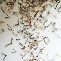 Marrying man-made woven metal with shapes in nature, British artist Michelle Mckinney creates ornate and mesmerising installations of leaves, birds, butterflies and the like.  http://www.michellemckinney.co.uk/