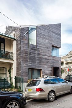 Faceted Sydney home clad with rough timber boards.