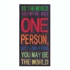 """by Accent Plus A fir wood frame is covered with a colorful canvas that will remind you daily of your importance in the world. The black background features multicolored text that reads, """"To the world you may be just one person, but to one person you may be the world""""."""