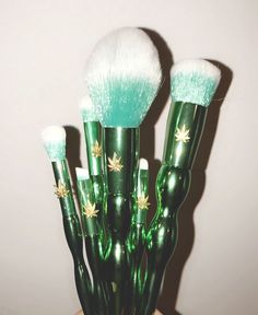 Cannabis beauty and cosmetics, hemp makeup, brushes, weed leaf and metallic green from staywildorganics.com