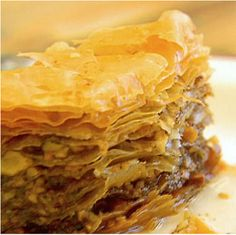 The best traditional Greek Baklava recipe! A classic Baklava dessert with layers of phyllo, walnuts and honey to amaze your guests with it's authentic taste Greek Desserts, Greek Recipes, Just Desserts, Dessert Recipes, Greek Baklava, Turkish Baklava, Food Network Recipes, Cooking Recipes, Phyllo Dough
