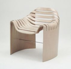 Molded plywood chair with the presence of a sculpture