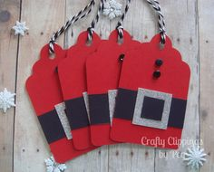 This set of 4 Santa Suit Christmas gift tags measures 3 x 4.    These red die cut tags feature a black belt with silver glitter buckle. Each one has 2 buttons (buttons are all black, but vary slightly on each one). Each tag includes and black and white twine to tie it on to a gift.    These will be a darling addition to your Christmas gifts.