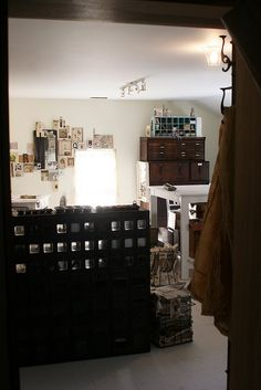 white + vintage wood storage pieces in Rebecca Sower's studio