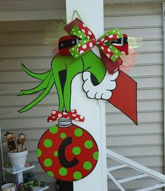 grinch holding ornament door hanger wooden door hangers wooden doors grinch christmas party - Pinterest Christmas Door Decorations
