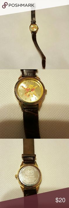 Disney Watch Celebrating 80 years Runs, leather strip is kinda bent. It has Tigger and Pooh on it. Disney Accessories Watches