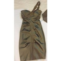 XSCAPE Olive One-Shoulder Cocktail/Evening Dress Size 4 Olive/Forest Green Satin-like One-shoulder Beaded Dress. Floral patterned beads on top. Stretchy Fabric with flattering ruching throughout. Light padding. Acetate/Nylon Spandex. Worn once and dry cleaned. Mint condition Xscape Dresses