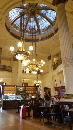 Café Retiro is located inside Retiro Station and is a wonderful example of an elegant turn-of-the-century café of Buenos Aires. Most Beautiful Cities, Architecture Design, The Neighbourhood, Ceiling Lights, Paris, Bs As, Times, Latin America, Patagonia