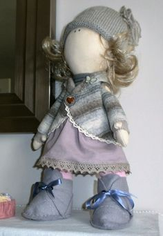 Another fabric doll created using no pattern,just my own sketches. Feel like I've learned a lot from this.Now she needs a name! Made by Audrey Haywood