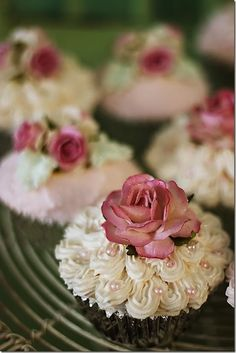 I want to do a small cupcake tower with really pretty tea party and flowers type cupcakes on it. Something like these.