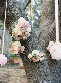 White & Pink Flower Arrangements on Tree | Photography: Caroline Tran. Read More: http://www.insideweddings.com/weddings/magical-garden-ceremony-tented-reception-with-chic-french-theme/733/