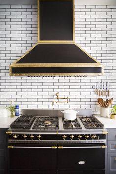 Black white and brass kitchen on domino.com