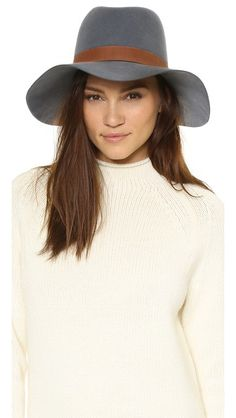 A Janessa Leone hat made from sturdy wool felt. A contrast nubuck band completes the sophisticated look.