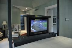 Retractable tv installed in the footboard.