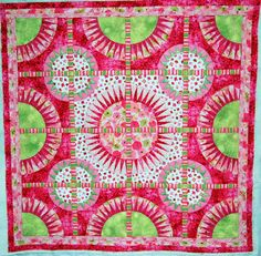 candy-colored: pink and green New York Beauty quilt, custom quilted by Kari Smith-Ruedisale (Michigan)