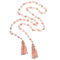 One of a kind Cathy Waterman tassel necklace featuring 39 round coral beads with touches of her signature floral diamond design, in platinum. 14.7k USD