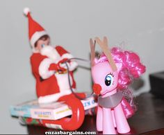 AWESOME Elf on the Shelf Ideas when I get my husband involved!  YEP, this Santa suit was ONLY $3!  Plus what a perfect little candy sleigh!  OXOX  I have tons of ideas-->Elf on the Shelf Ideas: Part 5