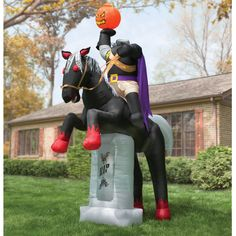 The 12' Inflatable Headless Horseman - Hammacher Schlemmer - This is the 12' tall inflatable headless horseman that creates an ominous presence in your own sequestered glen.