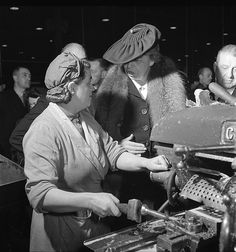 Eleanor Roosevelt with Female Machinist during Goodwill Tour, 1942.