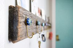 This wall-mounted rack was a quick DIY project. The piece of wood is an old floorboard found at Urban Ore, a salvage yard in Berkeley, and t...