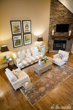 Sofa + arm chair arrangement, picture display above couch