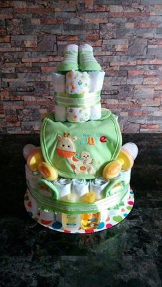 Sensible Products In Magical Diaper Cake Baby Shower Party Decorations - The Inside Track - Joy Baby Shower Nappy Cake, Diy Diaper Cake, Baby Shower Diapers, Baby Boy Shower, Diaper Shower, Baby Boy Diaper Cakes, Diaper Bag, Baby Shower Crafts, Baby Shower Parties