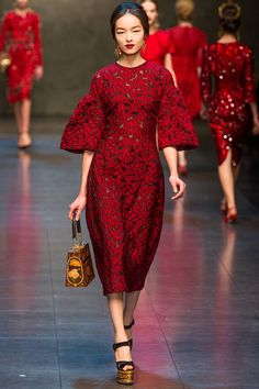 Dolce & Gabbana Fall 2013. Asian style kimono sleeves, teamed up with red lace. What a dream!