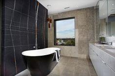 Aria_Sahara_Noir #accentwall #bath #bathroom #bathtub #stone #modern #ariastonegallery