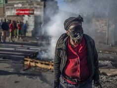 South Africa xenophobic attacks: Shops looted and violence on streets of Johannesburg as foreigners are forced to hide in police stations - Africa - World - The Independent