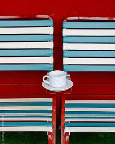 How about an afternoon cup of #coffee in #sanfrancisco ☕️ This #stockphoto is available via @stocksyunited search: #raymondforbesllc  #sanfran #coffeebreak #lawnchairs #redwhiteandblue #lawnchair #chairs #chair #stripes #vintage