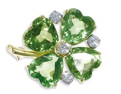 Estate Jewelry:Brooches - Pins, Peridot, Diamond, Gold Brooch. The brooch, designed as a four leafclover, features heart-shaped peridot measuring approxi...