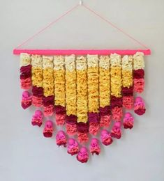 We love this stunning crepe paper petal wall hanging that Ashley Page Norton made on Oh Happy Day. Inspired by the celebratory floral torans of India, she strung together paper carnation-like petals to make a chevron pennant. Paper Crafts Origami, Diy Paper, Paper Art, Diy Wedding Backdrop, Flower Backdrop, Paper Backdrop, Ganpati Decoration Theme, Newspaper Crafts, Crepe Paper