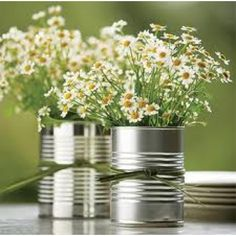 Save your soup cans! Flowers in cans! Love the idea for summer decorations around the house, or casual outdoor weddings.