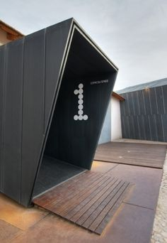shipping container museum exhibit entrance : environmental sinage