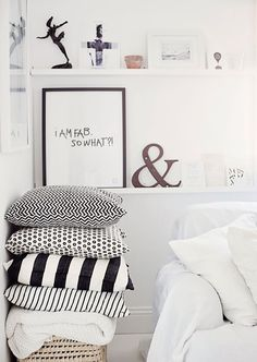Black and white patterned cushions in a cozy white home by Krist.In