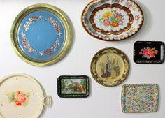 Vintage tin trays as wall art