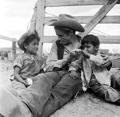 James Dean with some little friends on the set of Giant, photographed by Richard Miller, 1955.