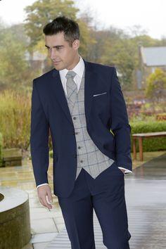 Slim fit blue suit with tweed waistcoat