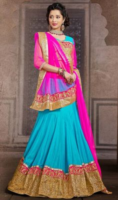 Cyan blue embroidered chiffon and silk flared lehenga choli is perfect for festive season party. The flared paneled lehenga is beautified with golden woven lace, silk thread embroidery on contrast pink border and crystal stones which adds charm and grace to your beauty. The contrast pink net dupatta has golden woven lace, silk thread embroidered border and crystal stones enhances the look of the lehenga. #LatestIndianTraditionalCholi