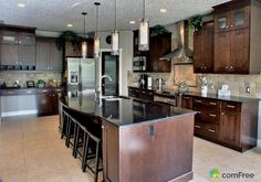 Dark granite kitchen counters. Medium-dark cabinets. Light tile. This would be nice for the kitchen