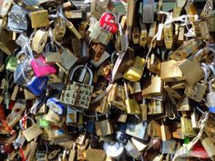 Here on the Pont de l'Archeveche bridge in Paris you can see some of the numerous love locks which crowd the bridge.  Daily updates at www.eutouring.com