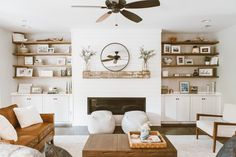 Traditional Knoxville home updated with a shiplap fireplace, built-ins, wood wrapped columns and new furniture to reflect the family's modern industrial style. Fireplace Shelves, Fireplace Built Ins, Home Fireplace, Living Room With Fireplace, Fireplace Design, Home Living Room, Living Room Designs, Living Room Decor, Shiplap Fireplace