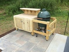Another view of the prep table for the Big Green Egg. I looked for the best table at the retail shops and they all wanted $400-$900 for something that was basically a small table with a hole in it. I built this for a fraction of their price and it has enclosed storage!