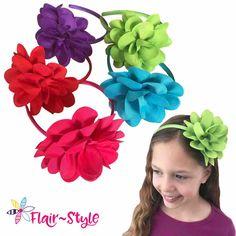 "Sure to make an impact, each headband features a 5"" grosgrain ribbon flower."