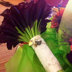 My daughter's bouquet wrapped in Lace from my Wedding Veil and her Grandmother's Lockets and Grandfather's Ring...60 Purple Calla Lilies