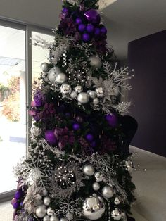 Purple and silver christmas tree. Design by Kathy Thomas