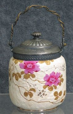 Furnival earthenware biscuit jar with silver plate top and swing handle raised leaf design with enamelled and gilt vine and flowers
