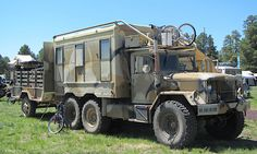 Wolf (first, last, and only name) has been working for Burning Man for the past 13 years. He and his girlfriend Elise drive two of these trucks all over the country on overlanding expeditions. This 2.5-ton AM General military truck is an M109 (an M35A2 truck equipped with a workshop box) with a White multifuel engine. They bought the truck three years ago and gutted the shop box to outfit it for camping. It's an ongoing project, but from what we saw, the interior is cozy.  The couple…