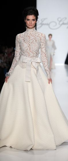 This Igor Gulyaev gown would be stunning for a winter wedding! The full skirt, long sleeved high collared lace bodice and bow are to die for!